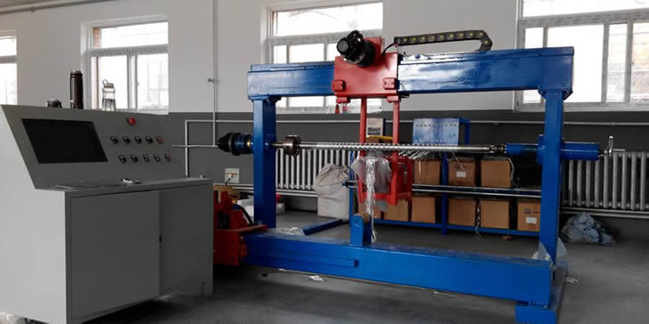 A blue portal filament winding machine is perfect for fabricating small pressure pipes and gas cylinders.