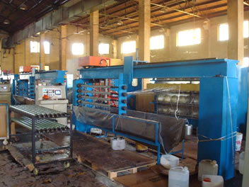 The picture shows winding machine with blue frame, which is installed with five axis.