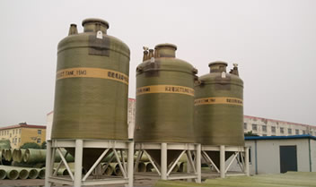 Several FRP depositing tanks are mounted on the steel shelves.
