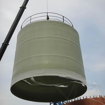 A vertical FRP tank is demoulded from the mandrel with the help of hoist machine.