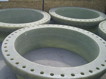 Several large FRP flanges are on the ground.