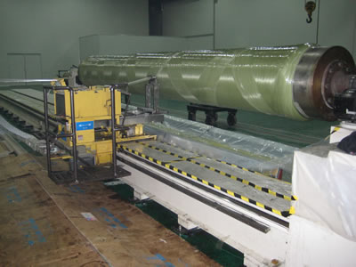 One process pipe winding machine is working in the warehouse.