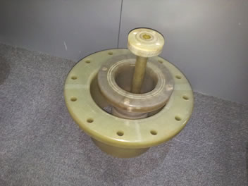 Three small FRP flanges are on the ground, and they have different sizes.
