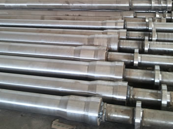 Various steel pipe mandrels are placed on the floor prior to shipment
